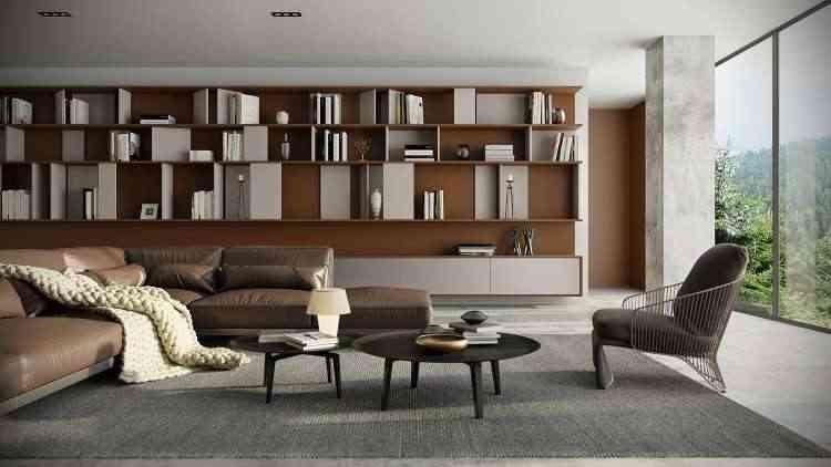 No living, o metal casa bem o concreto com a luminosidade do ambiente. A poltrona é a peça-chave  - Rehau Brasil/Divulgação