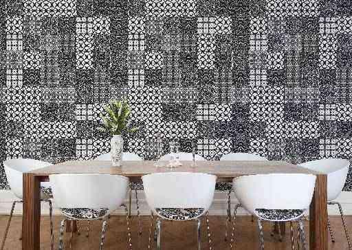 Projeto da Denise Delalamo cria uma parede que é a grande estrela do ambiente. O preto e o branco sempre serão sinônimos de sofisticação - Denise Delalamo/Divulgação