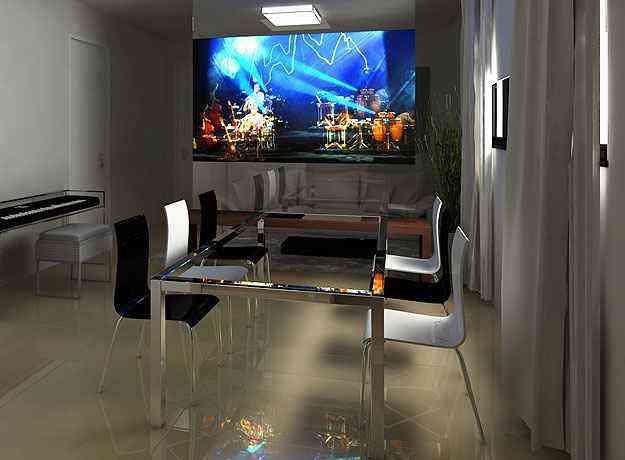 O escritório Izabel Souki utiliza TV retrátil e móveis sob medida para compor a decoração - Izabel Souki Engenharia e Projetos/Divulgação