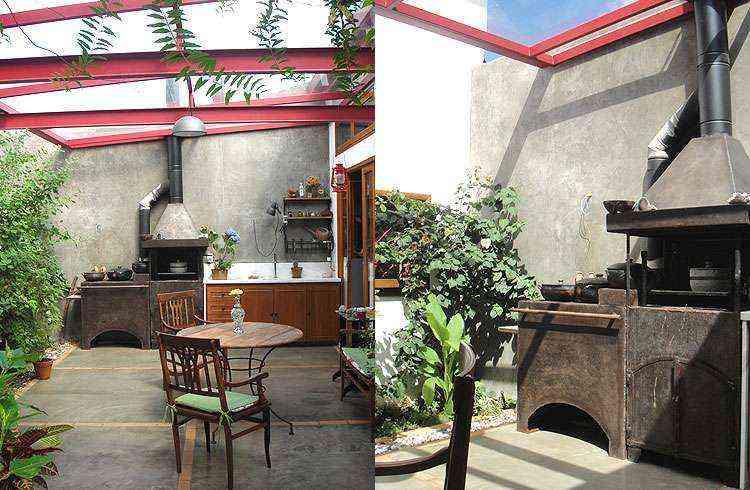 Na ambientação do espaço gourmet de uma residência, a arquiteta Fernanda Neiva usou um fogão a lenha em aço fundido, com churrasqueira acoplada, para agradar a proprietária, amante da cozinha - Fernanda Neiva/Divulgação