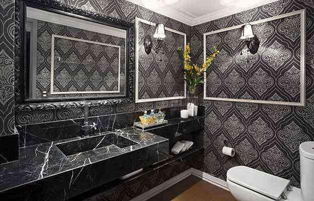 O mármore escuro é uma opção clássica para o lavabo masculino. A concepção é do arquiteto Moacir Melo - Haruo Mikami/Divulgação