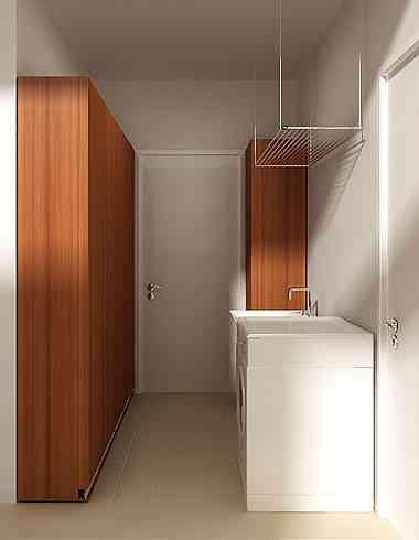 Na área de serviço, é possível aproveitar totalmente o espaço com móveis sob medida - Izabel Souki Engenharia e Projetos/Divulgação
